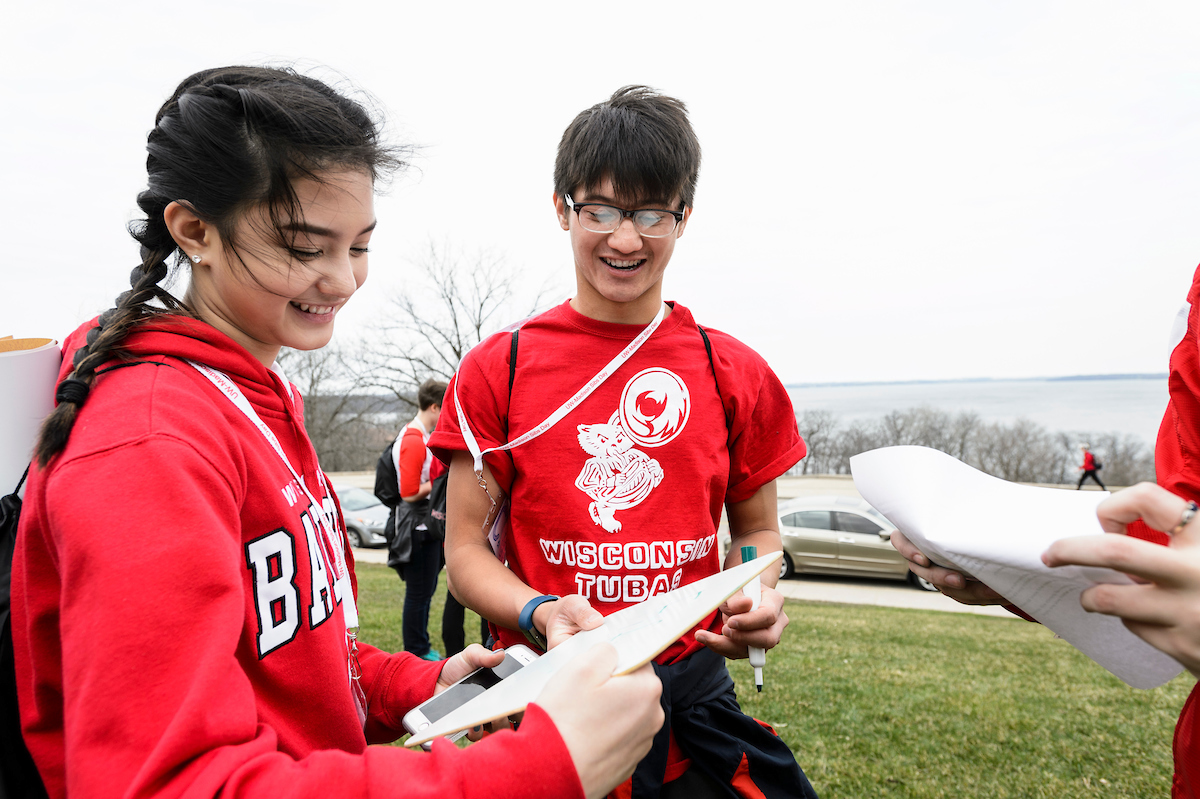 Students participate in a Siblings Day scavenger hunt