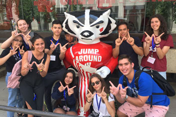 2020 EdUSA cohort with Bucky Badger statue making W sign